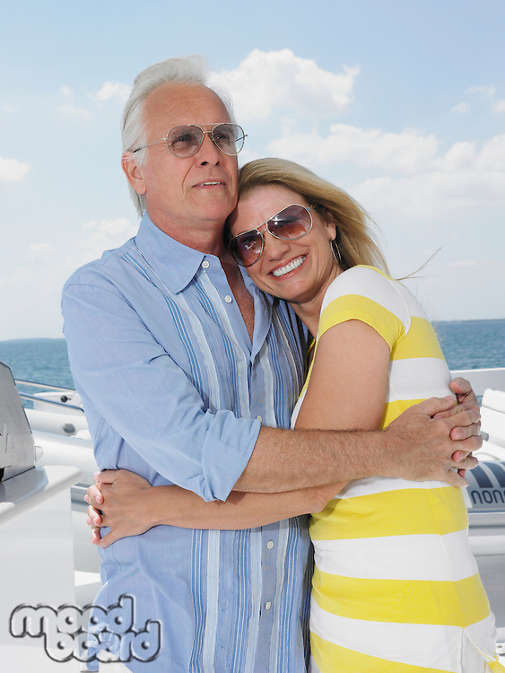 Middle-aged couple embracing on yacht portrait