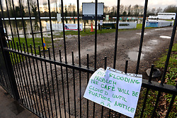 Pictured is a cafe closure notice next to East Molesey Cricket pitch, in Surrey, UK, that has been flooded. Heavy rain and storms have lead to the Thames bursting it's banks.<br /> Monday the 10th of February 2014. Picture by Ben Stevens / i-Images