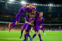 LONDON, ENGLAND - Saturday, November 3, 2018: Liverpool's captain James Milner is mobbed by team-mates as he celebrates the first goal during the FA Premier League match between Arsenal FC and Liverpool FC at Emirates Stadium. The game ended in a 1-1 draw. Trent Alexander-Arnold, Fabio Henrique Tavares 'Fabinho', Roberto Firmino, Andy Robertson, Sadio Mane. (Pic by David Rawcliffe/Propaganda)