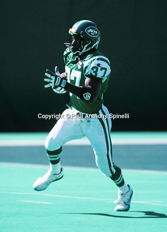 New York Jets kick returner Anthony Prior (37) returns a kick during the NFL football game against the New England Patriots on Oct. 16, 1994 in East Rutherford, N.J. The Jets won the game 24-17. (©Paul Anthony Spinelli)