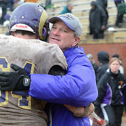 Staff photos by Tom Kelly IV<br /> West Chester head coach Bill Zwaan hugs Chris DiValentino (64) following the West Chester University at Lenoir-Rhyne University (Hickory, NC) NCAA Division II semifinal game, Saturday December 14, 2013.  WCU lost by a score of 42-14.