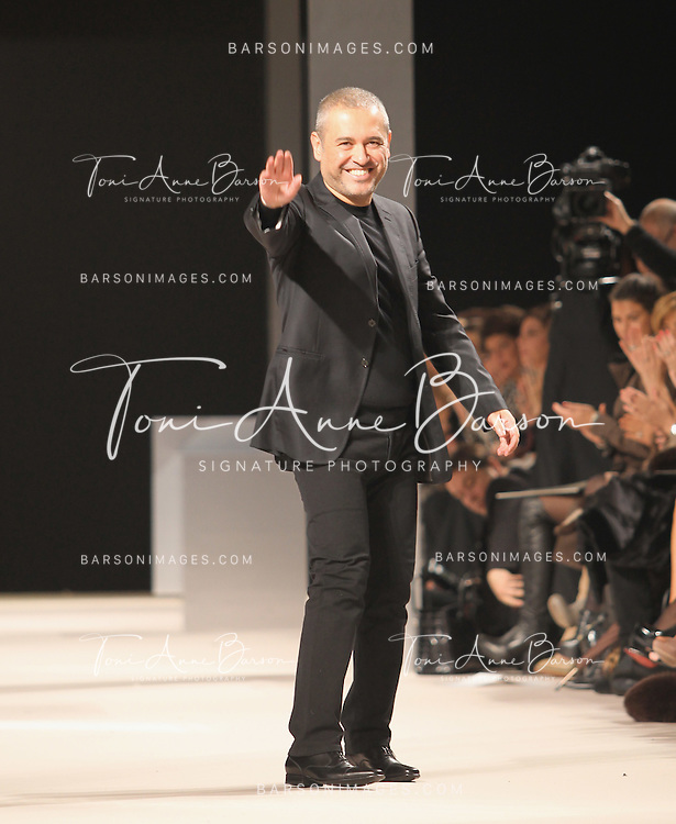 PARIS - JANUARY 26:  Designer Elie Saab walks the runway during the Elie Saab show as part of the Paris Haute Couture Fashion Week Spring/Summer 2011 at Palais de Chaillot on January 26, 2011 in Paris, France.  (Photo by Tony Barson/WireImage)