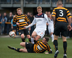 Falkirk's Jay Fulton tackled by Alloa Athletic's Jason Marr.<br /> Half time : Alloa Athletic 0 v 0 Falkirk, Scottish Championship 12/10/2013. played at Recreation Park, Alloa.<br /> &copy;Michael Schofield.