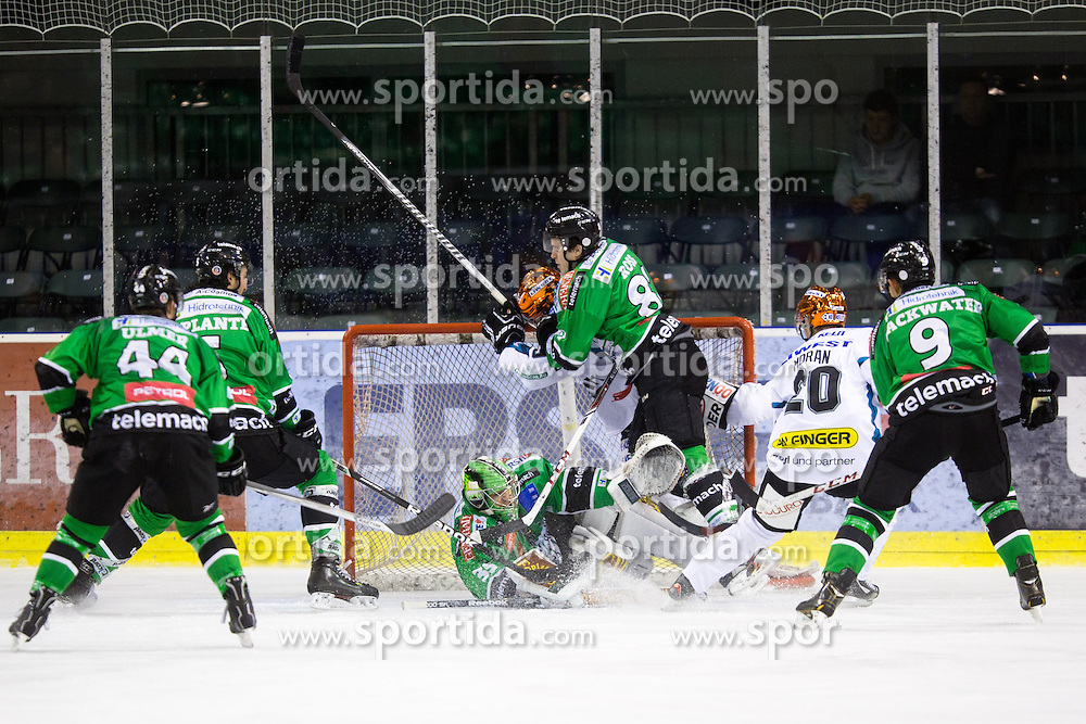 01.10.2013, Hala Tivoli, Ljubljana, SLO, EBEL, HDD Telemach Olimpija Ljubljana vs EHC Liwest Linz, 14th Game Day, in picture Player of EHC Liwest Linz crashes into net by Jerry Kuhn (HDD Telemach Olimpija, #35) during the Erste Bank Icehockey League 14th Game Day match between HDD Telemach Olimpija Ljubljana and EHC Liwest Linz at the Hala Tivoli, Ljubljana, Slovenia on 2013/10/01. (Photo By Matic Klansek Velej / Sportida)
