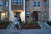 Women walk past completed town homes at the Taylor Morrison town home project on the 1500 block of McCandless Drive in Milpitas, California, on July 21, 2014. (Stan Olszewski/SOSKIphoto)