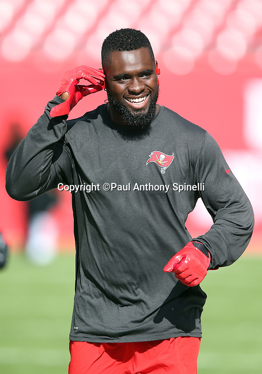 Tampa Bay Buccaneers strong safety Major Wright (31) has a laugh as he adjust his headphones while warming up before the 2015 week 14 regular season NFL football game against the New Orleans Saints on Sunday, Dec. 13, 2015 in Tampa, Fla. The Saints won the game 24-17. (©Paul Anthony Spinelli)