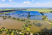 Nederland, Zuid-Holland, Gemeente Reeuwijk, 15-07-2012; Reeuwijksche Plassen (Reeuwijkse Plassen), Sluipwijk in de voorgrond. De veenplassen zijn ontstaan door het afgraven en wegbaggeren van het veen voor het winnen van turf. Uitzondering is de plas in de achtergrond, dit is een zandwinplas ontstaan door het winnen van zand, nodig voor de aanleg van de A12..Residential area in the middle of the recreation area and peat lakes Reeuwijksche Plassen,  created by peat and sand extraction..luchtfoto (toeslag), aerial photo (additional fee required).foto/photo Siebe Swart