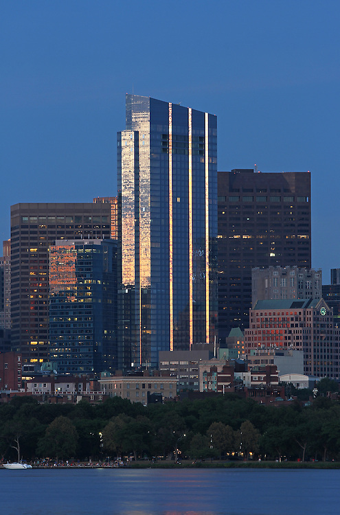 Skyline photography featuring the newly constructed Boston Millenium Tower on a magnificent summer night. The Millennium Tower, with its nickname Millie, is located at Downtown Crossing and is one of the latest Boston urban architecture skyline addition. Boston skyline photos are available as museum quality photography prints, canvas prints, acrylic prints or metal prints. Fine art prints may be framed and matted to the individual liking and decorating needs:<br />