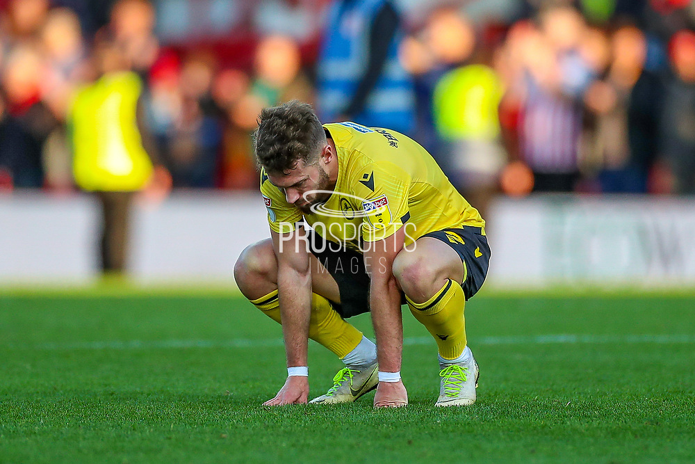 Millwall forward Tom Bradshaw (9) looks crushed at full time during the EFL Sky Bet Championship match between Brentford and Millwall at Griffin Park, London, England on 19 October 2019.
