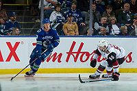 KELOWNA, BC - SEPTEMBER 29: Jason Demers #55 of the Arizona Coyotes tries to block the pass of Jake Virtanen #18 of the Vancouver Canucks during third period at Prospera Place on September 29, 2018 in Kelowna, Canada. (Photo by Marissa Baecker/NHLI via Getty Images)  *** Local Caption *** Jake Virtanen;Jason Demers