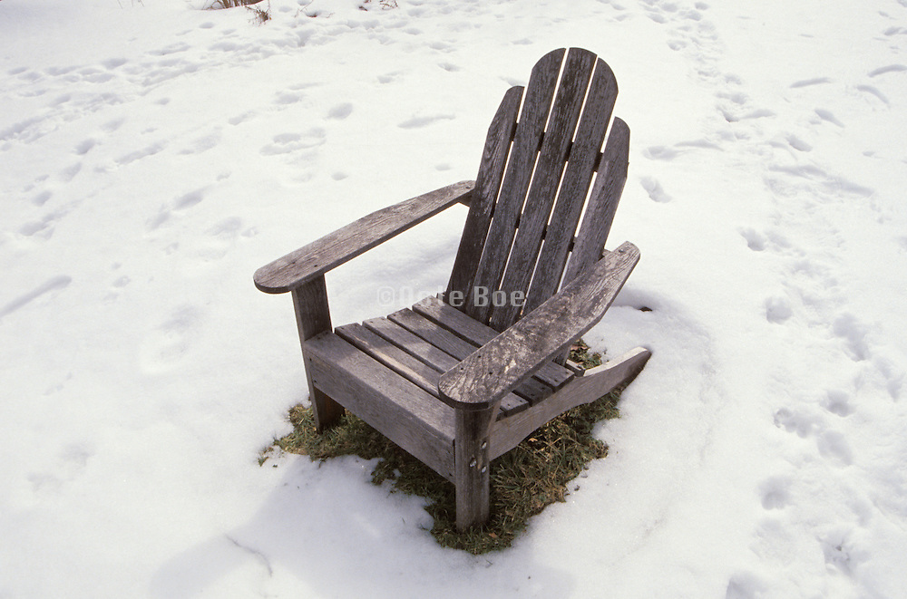 abandoned chair in snowy yard