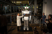 "UNITED KINGDOM, London: 10 May 2016 Humanoid robot ""Cygan"", built in Italy in 1957, gets a closer look by a technician at The Science Museum earlier this morning. The robot features as part of the Rise of the Robots exhibition, revealing the remarkable 500 year history of robots. Rick Findler / Story Picture Agency"