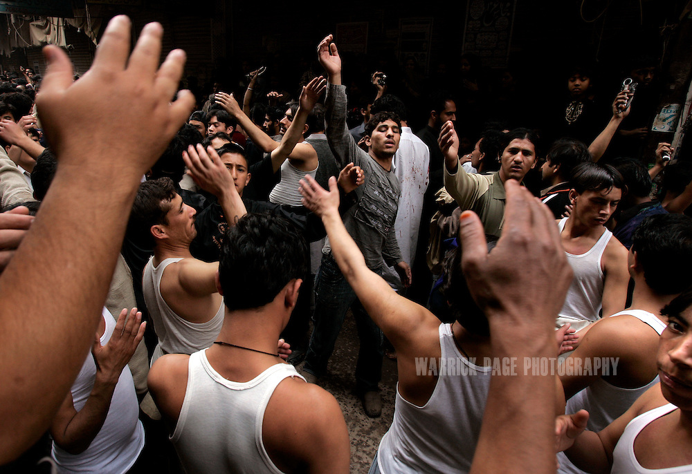 Shia Muslims beat their chests during Ashura rituals on January 30, 2007, in Lahore, Pakistan. Millions of Muslims worldwide observe Ashura during the month of Muharram to mourn the death of the Prophet Mohammed's grandson Immam Hussain. Some Shia participate in self-flagelation to punish themselves for failing to protect the prophet's grandson. Many Shia, however, see this act as unnecessary. During the month of Muharram, many Shia's give generously to the poor and spend time in prayer. Security is stepped up every year throughout the country during Ashura due to ongoing violence between Shia and Sunni Muslim groups who frequently attack during opposing religious observances. (Photo by Warrick Page)