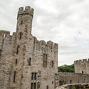 Some of the turrets at Caernarfon Castle in northwest Wales. A castle originally stood on the site dating back to the late 11th century, but in the late 13th century King Edward I commissioned a new structure that stands to this day. It has distinctive towers and is one of the best preserved of the series of castles Edward I commissioned.