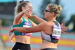 Orla Comerford, IRE, Janne Sophie Engelieter, GER celebrating after finishing the T13 100m at the Berlin 2018 World Para Athletics European Championships
