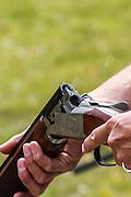 Ejecting shotshell form an over/under shotgun at a range