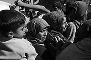 21 April 2016, Greece, Idomeni - Women Refugees wait in line for the food.