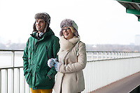Happy couple walking on footpath during winter