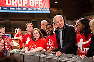Vice President Joseph R. Biden, second from right, participates in the National Day of Service at the Unite America in Service event at the DC Armory on Saturday, January 19, 2013 in Washington, DC.