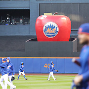 The New York Mets big apple with a plaster on it where Travis d'Arnaud's game one home run hit shown during warm up before the MLB NLCS Playoffs game two, Chicago Cubs vs New York Mets at Citi Field, Queens, New York. USA. 18th October 2015. Photo Tim Clayton