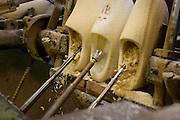 Klompen worden uitgefreesd. Produktie bij de grootste klompenfabriek ter wereld, Klompenfabriek Nijhuis B.V. in Beltrum. Voor de productie van klompen worden speciale en zelf ontwikkelde machines gebruikt. Hoewel het principe al erg oud is, worden de productietechnieken nog steeds verbeterd.<br /> <br /> Wooden shoes are being milled. Production at the biggest manufacturer of wooden shoes, Klompenfabriek Nijhuis B.V. at Beltrum (NL). For the production special and self developed machines are used. Although the principe of the manufacturing is very old, the techniques are still being improved.