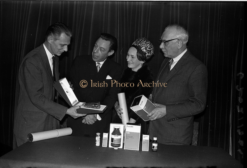 """17/12/1962<br /> 12/17/1962<br /> 17 December 1962<br /> Presentation of Packaging Awards at the Shelbourne Hotel, Dublin. Leo (Ireland) Ltd. had won the """"Eurostar"""" international award for packaging. Picture shows (l-r0: Mr. B. Schou Lund; Mr. W.H. Walsh; Mrs R. Walker and Mr. I.W. Robertson, joint managing director of Hely-Thom Ltd, by whom the winning packs were printed."""