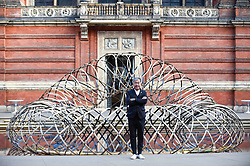 "© Licensed to London News Pictures. 13/09/2019. LONDON, UK. Designer Kengo Kuma in front of his work ""Bamboo Ring"" on display at the V&A museum as part of London Design Festival.  The festival, now in its 17th year, includes installations across the capital and runs 14 to 22 September 2019.  Photo credit: Stephen Chung/LNP"