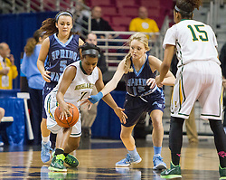 Huntington guard Alacyah Johnson (11) and Spring Valley guard Karlee Alderman (15) fight for a loose ball during a first round game at the Charleston Civic Center.