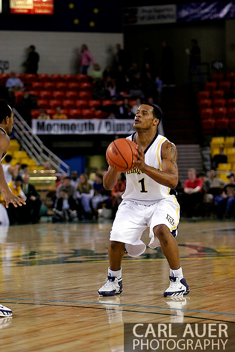 25 November 2005: Marquette Golden Eagle Dominic James (1), a freshman guard, squares for a three point shot in the Marquette University 73-70 victory over Oral Roberts University at the Great Alaska Shootout in Anchorage, Alaska