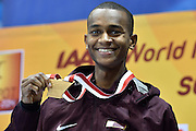 Mutaz Essa Barshim of Qatar with his gold medal and World Champion title after men's high jump final while medal ceremony during the IAAF Athletics World Indoor Championships 2014 at Ergo Arena Hall in Sopot, Poland.<br /> <br /> Poland, Sopot, March 9, 2014.<br /> <br /> Picture also available in RAW (NEF) or TIFF format on special request.<br /> <br /> For editorial use only. Any commercial or promotional use requires permission.<br /> <br /> Mandatory credit:<br /> Photo by &copy; Adam Nurkiewicz / Mediasport