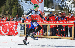 17.03.2017, Ramsau am Dachstein, AUT, Special Olympics 2017, Wintergames, Schneeschuhlauf, Divisioning 100 m, im Bild Neda Pabilionyte (LTU) // during the Snowshoeing Divisioning 100 m at the Special Olympics World Winter Games Austria 2017 in Ramsau am Dachstein, Austria on 2017/03/17. EXPA Pictures © 2017, PhotoCredit: EXPA / Martin Huber