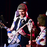 """Banjo player """"Babyface Mahoney"""" performs with Vaud and the Villains at The Music Hall in Portsmouth, NH. July 2012."""