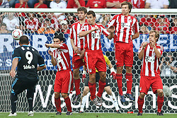 07.08.2010,  Augsburg, GER, 1.FBL, Supercup, FC Bayern Muenchen vs FC Schalke 04,  im Bild Freistufl  durch Edu (Schalke #9) mit Thomas Mueller (Bayern #25) Miroslav Klose (Bayern #18) Holger Badstuber (Bayern #28) , EXPA Pictures © 2010, PhotoCredit: EXPA/ nph/ . Straubmeier+++++ ATTENTION - OUT OF GER +++++ / SPORTIDA PHOTO AGENCY
