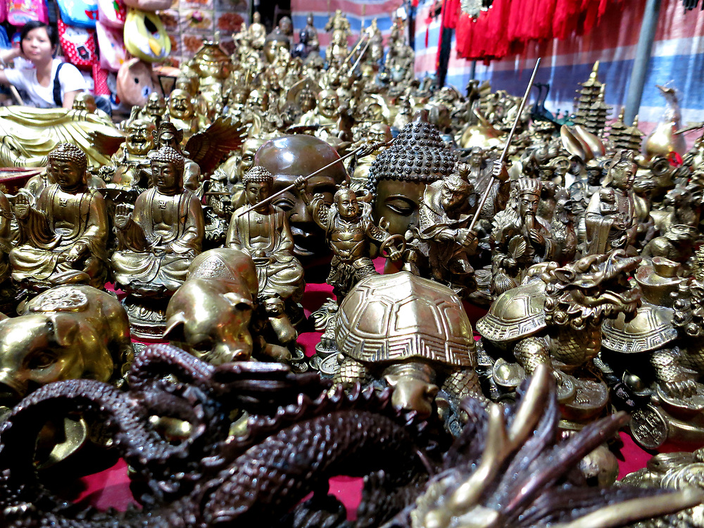 Brass figurines for sale at the night market, Kowloon, Hong Kong, China; September, 2013.