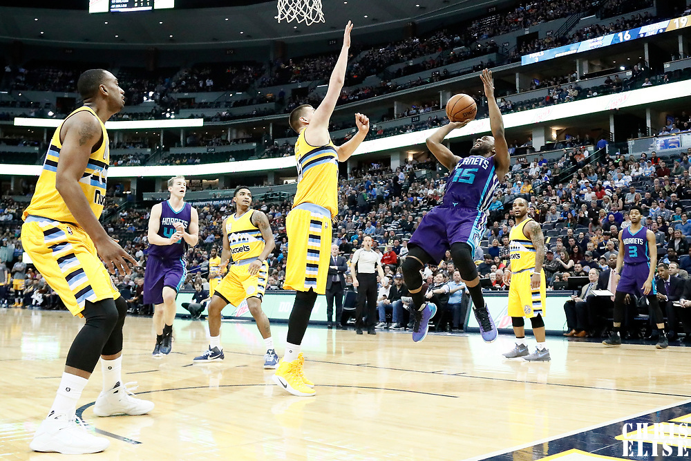 04 March 2017: Charlotte Hornets guard Kemba Walker (15) takes a jump shot over Denver Nuggets forward Nikola Jokic (15) during the Charlotte Hornets 112-102 victory over the Denver Nuggets, at the Pepsi Center, Denver, Colorado, USA.