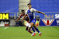 Bristol City's Niclas Eliasson (left) and Wigan Athletic's Antonee Robinson (right) battle for the ball during the Sky Bet Championship match at the DW Stadium, Wigan.