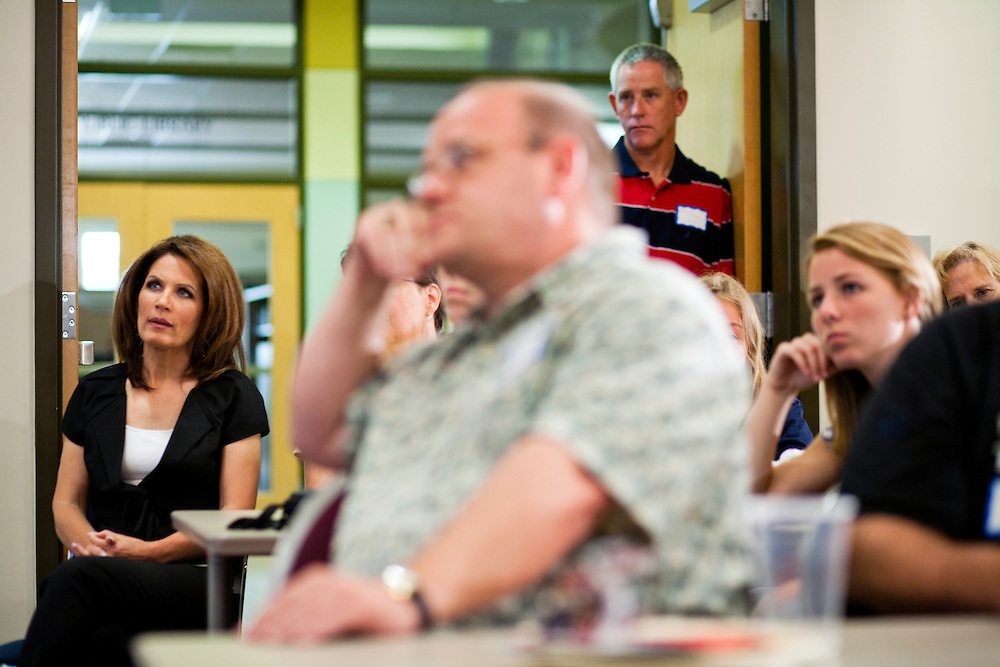 Republican presidential candidate Michele Bachmann (R-MN), left, listens as she is introduced by Rep. Steve King (R-IA) during a campaign stop at the Calhoun County Republican Party dinner on Monday, August 8, 2011 in Rockwell City, IA.