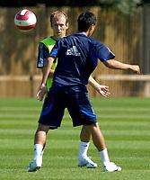Photo: Daniel Hambury.<br />Chelsea Training Session. The Barclays Premiership. 24/07/2006.<br />Arjen Robben passes the ball during training.