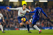 Tottenham Hotspur midfielder Erik Lamela (11) and Chelsea defender Ngolo Kante (7) go for the ball during the Premier League match between Chelsea and Tottenham Hotspur at Stamford Bridge, London, England on 27 February 2019.