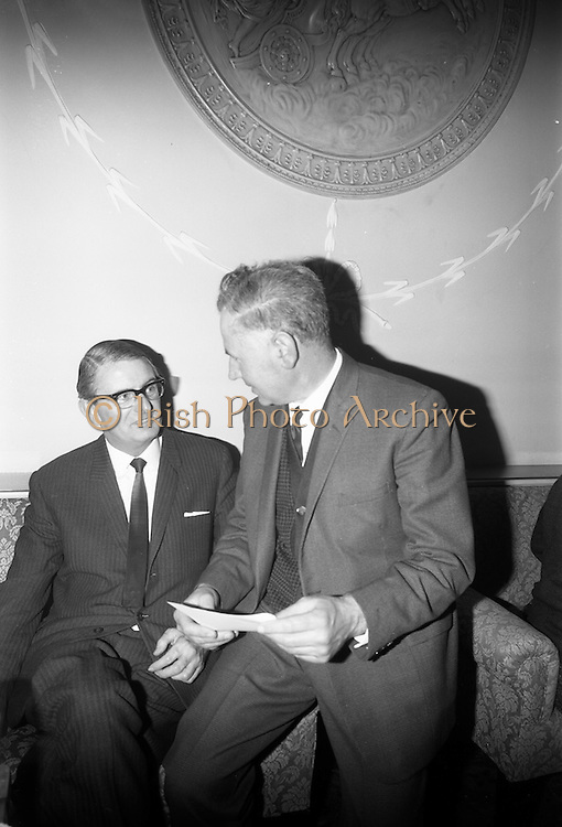 18/2/1966<br /> 2/18/1966<br /> 18 February 1966<br /> <br /> Mr. P.J. Gough General Manager Bolands Bakery chatting with Mr. Patrick Cullinan Principal Officer Dept. of Education at the reception