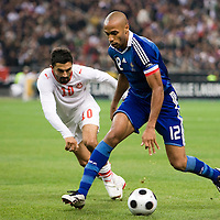 14 October 2008: French forward Thierry Henry #12 vies with Tunisian Fahid Ben Khalfallah #10 during the friendly football match won 3-1 by France over Tunisia on October 14, 2008, at the Stade de France in Saint-Denis, near Paris, France.