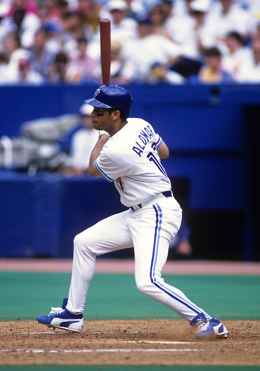 TORONTO - 1994:  Roberto Alomar of the Toronto Blue Jays bats during an MLB game at Skydome in Toronto, Ontario.  Alomar played for the Blue Jays from 1991-1995.  (Photo by Ron Vesely)