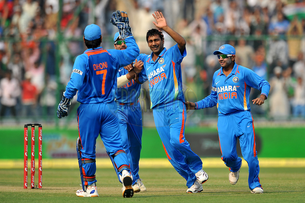 Praveen Kumar of India celebrates the wicket of Alastair Cook of England  during the 2nd One Day International ( ODI ) match between India and England held at the The Feroz Shah Kotla Stadium, Delhi on the 17th October 2011..Photo by Pal Pillai/BCCI/SPORTZPICS