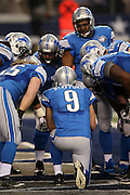 Detroit Lions quarterback Matthew Stafford (9) calls a play in the offensive huddle during the NFL week 18 NFC Wild Card postseason football game against the Dallas Cowboys on Sunday, Jan. 4, 2015 in Arlington, Texas. The Cowboys won the game 24-20. ©Paul Anthony Spinelli