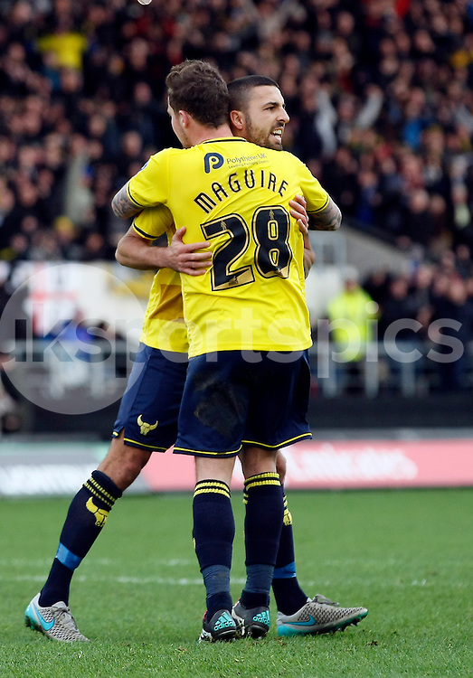 Scorer Liam Sercombe is congratulated by Chris Maguire during the The FA Cup match between Oxford United and Swansea City at the Kassam Stadium, Oxford, England on 10 January 2016. Photo by Dave Peters.