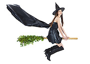 beautiful witch flying on broomstick with cape