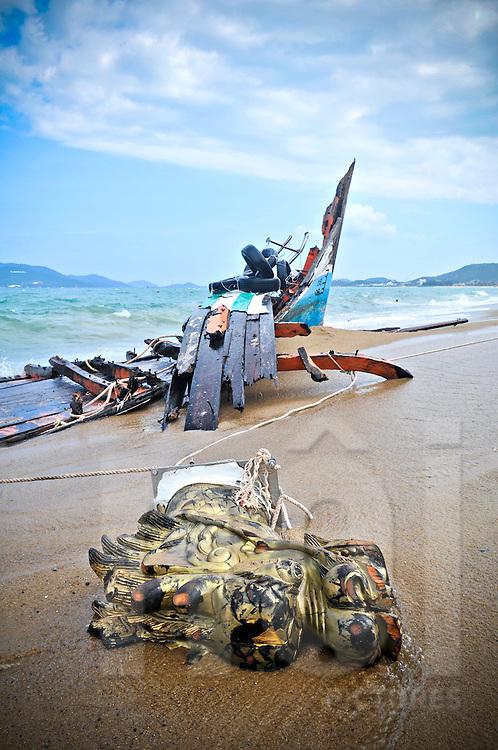 Ships prow lies in the sand beside more ship wreckage on Nha Trang beach, Khanh Hoa Province, Vietnam, Southeast Asia
