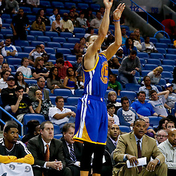 Mar 18, 2013; New Orleans, LA, USA; Golden State Warriors point guard Stephen Curry (30) shoots a three pointer  during the second half of a game at the New Orleans Arena. The Warriors defeated the Hornets 93-72.  Mandatory Credit: Derick E. Hingle-USA TODAY Sports