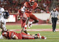 September 16, 2017 - Houston, TX, USA - Houston Cougars wide receiver Linell Bonner (15) leaps a teammate while carrying the ball during the second quarter of the college football game between the Houston Cougars and the Rice Owls at TDECU Stadium in Houston, Texas. (Credit Image: © Scott W. Coleman via ZUMA Wire)