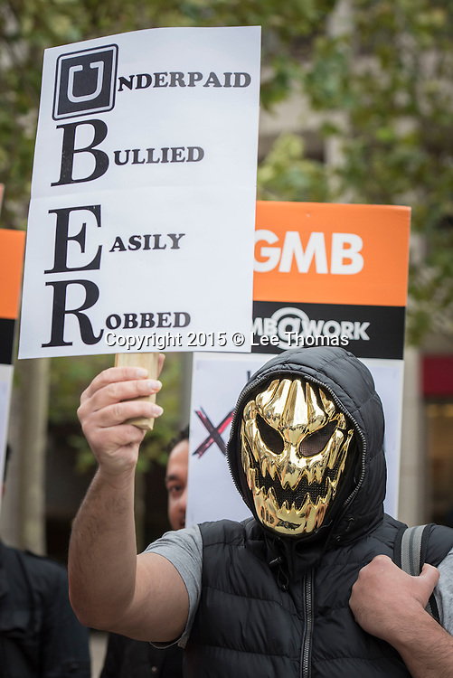 Near to Uber Offices, Mansell Street, London, UK. 12th November, 2015. Uber Drivers stage a protest near to the company's offices in Mansell Street over Uber increasing levy on driver's Income from 20% To 25%. On 29th Oct 2015 solicitors Leigh Day, acting on behalf of GMB members working for Uber, issued a claim at the London Central Employment Tribunal that the company does not provide drivers with basic workers' rights such as pay, holidays, health and safety and on raising complaints. During the protest road traffic came to a halt in the east London area surrounding Uber's offices.  Pictured:   // Lee Thomas, Flat 47a Park East Building, Bow Quarter, London, E3 2UT. Tel. 07784142973. Email: leepthomas@gmail.com. www.leept.co.uk (0000635435)